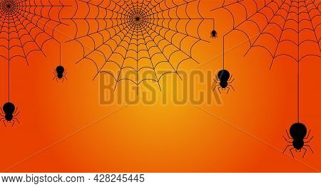 Black Spider Hanging From Cobweb On Orange Background With Copy Space. Halloween Concept. Design For