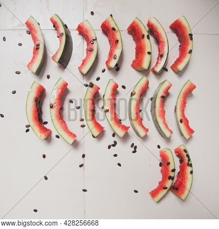 Group Of Watermelon Rinds Arranged In Rows On A Gray Background. Creative Concept Of Pop Art Install