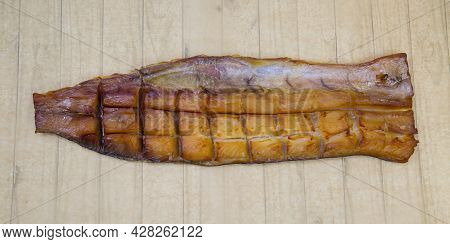 Pike Jukola (latin: Esox Lucius) Is Appetizing On A Round Plate With A Wooden Table Background. Food