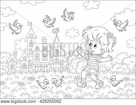 Happy Little Girl Playing With A Small Flock Of Merry Sparrows And Titmice In A Summer Park Of A Pre