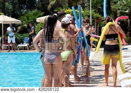 Marmaris, Turkey - July 2021: Women Doing Aqua Aerobics On A Poolside. Water Sport, Workout And Ente