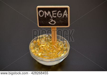 Fish Oil Capsules In A Bowl And Omega 3 Lettering