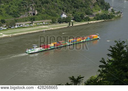 Loreley, Germany - 25 July 2021. A Large Barge Carrying A Lot Of Containers On The Rhine River In We