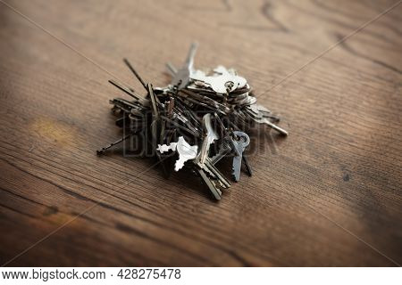 Too many password or security concept image.Bunch of tangled old keys on wooden table.Security and encryption, concept image.