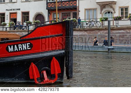 Strasbourg, France, June 23, 2021 : A Barge At Quay On The River Ill In Strasbourg City Center.