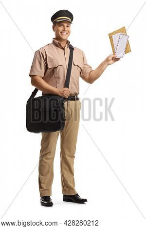 Full length portrait of a postman in a uniform holding letters and smiling isolated on white background