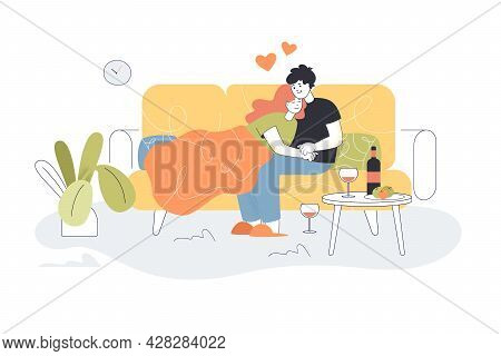 Cute Couple Hugging On Couch At Home. Boyfriend And Girlfriend Sitting On Sofa, Champagne Or Wine An