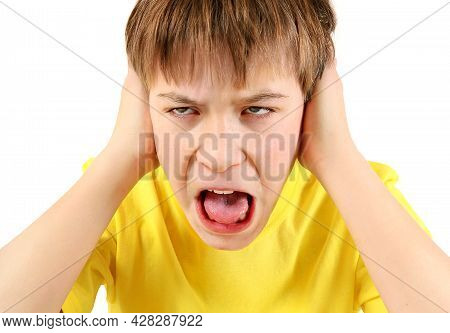 Annoyed Teenager Close The Ears And Yelling On The White Background Closeup