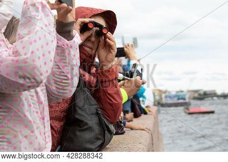 July 22, Russia, St. Petersburg. Spectators With Binoculars And Optics On The Embankment Of The Neva
