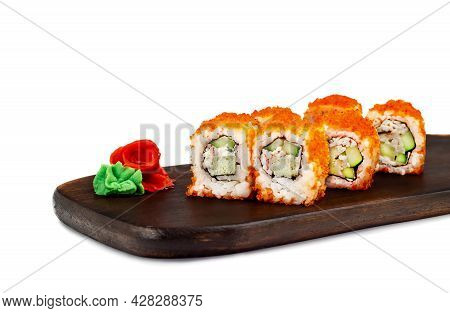 Traditional Delicious Fresh Sushi Roll On A Wooden Board, Isolate. Sushi Roll With Rice, Tofu Cheese