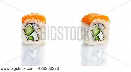 set of sushi rolls on a white background with reflection. Sushi roll with rice, avocado, red fish, salmon. Sushi menu. Japanese and Asian cuisine, restaurant. Seafood