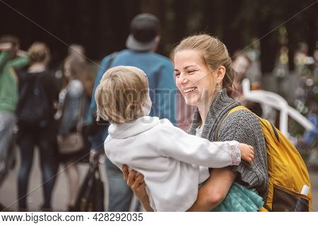 July 8, 2016 Kolomna, Moscow Region, Russia. Happy Young Woman Lovingly Embraces A Child In The Park