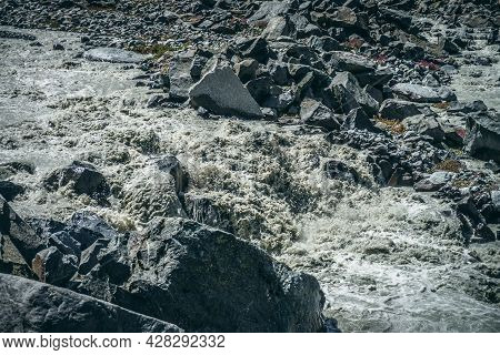 Atmospheric Landscape With Powerful Rapids Of Turbulent Mountain River With Gray Water Among Big Bou
