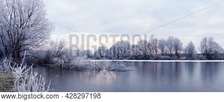 Picturesque Winter Landscape With Snow-covered Trees By The River On A Winter Morning In Cold Winter