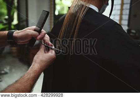 Close-up Haircut By A Professional Stylist. Hairdresser Cutting Hair In Beauty Salon