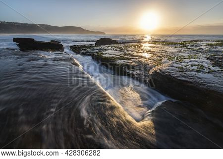 Water Into A Gutter At Killcare Beach On Nsw Central Coast