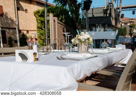 Served Table In The Open-air Restaurant. Concept Of Holidays And Wedding. Hotel Restaurant Business