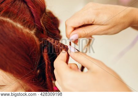 Girl Hairdresser Weaves Woman Ginger Dreadlocks. Close Up Of Braiding Process African Plaits With Co