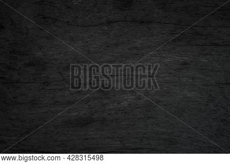 Abstract Vignette Black Wood Texture High Quality Close Up. Dark Furniture Plank Material Wallpaper.
