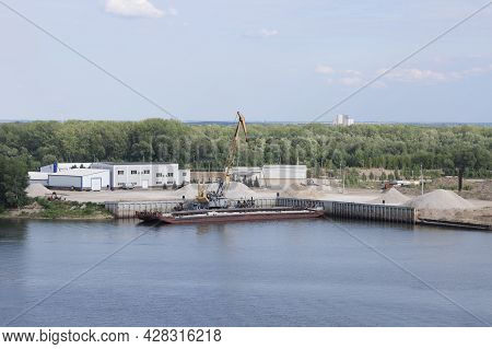 Unloading A Barge In A River Port, Gantry Crane Unloading Crushed Stone, Background