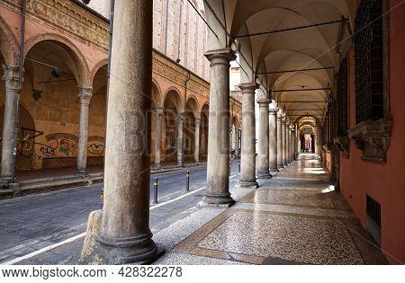 Bologna - Italy - July 3, 2021: Famous Arcade Of Bologna. Via Zamboni. Unesco Heritage Since 2021. I