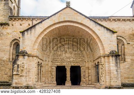 View At The Decorative Portal Of Church And Abbey Of Saint Pierre In Beaulieu-sur-dordogne - France