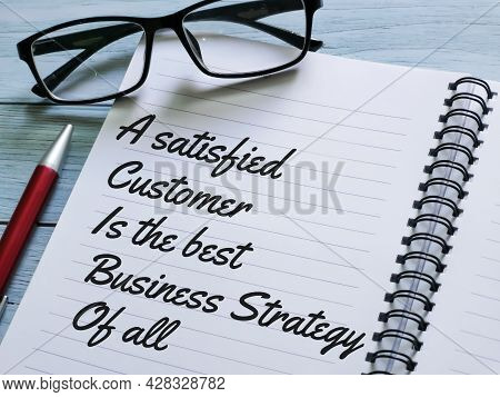 Phrase A Satisfied Customer Is The Best Business Strategy Of All Written On Notebook With A Pen.