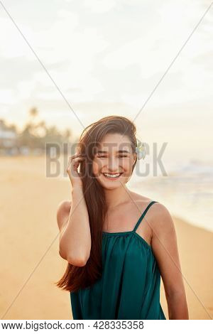 Happy Woman On  Beach. Beautiful Girl. Young Pretty Girl. Smiling Woman Portrait.