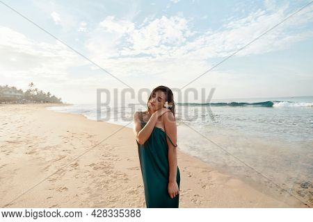 Portrait Of Beautiful Young Woman In Dress On The Beach. Pretty Girl On Tropical Beach. Freedom Conc