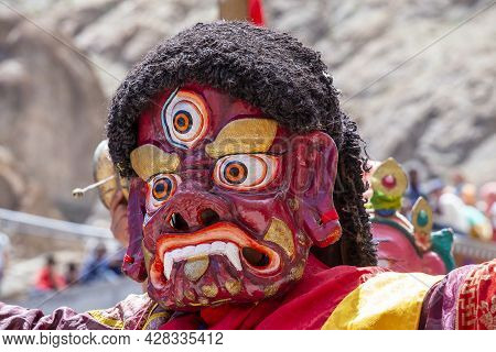 Tibetan Man, Dressed In A Mystical Mask, Perform A Dance During The Buddhist Festival In Hemis Monas