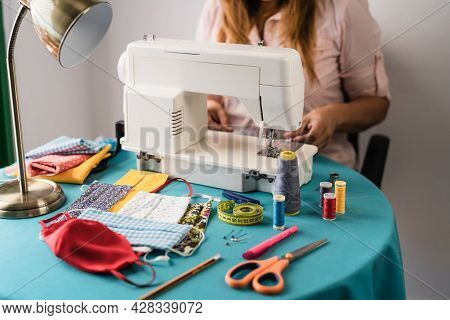 Female Working With Sewing Machine Doing Homemade Face Mask For Preventing And Stop Corona Virus Spr