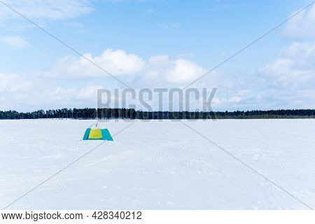 Ice Fishing Tent Northern Pike Fishing On The Frozen Lake. Winter Sports