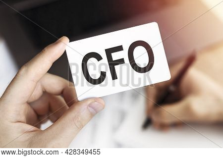 Businessman's Hand Holding A Card With Letters Cfo - Chief Financial Officer.