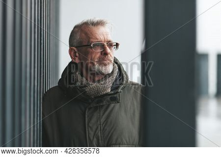 Memories And Melancholy In Old Age. Portrait Of A Senior Wrinkled Man Outside. Loss Of A Loved One,