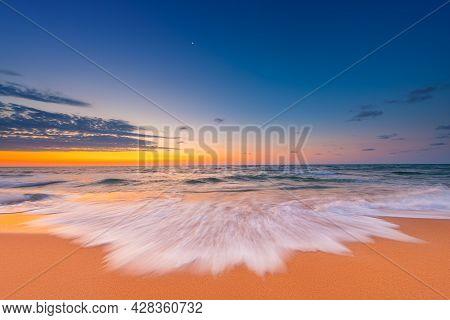 Beach Sunrise Over The Tropical Sea And Shore