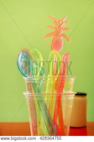 Colorful Drinking Straws In Glass, Plastic Spoon And Plastic Spatula Tool Kitchenware For Ice Cream.