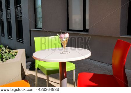 Ice Cream Holders On Table. Strawberry, Mint, Vanilla With Sour Cherry Ice Cream In Large Waffle Con