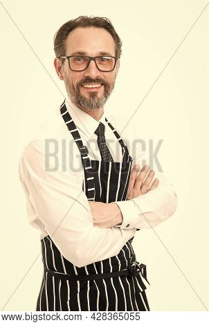 Feeling Confident In Apron. Bearded Man Baker In Glasses. Catering Business. Mature Male Cook Isolat