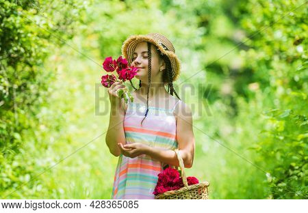 Nice Smell. Spring Kid Fashion. Girl With Rose Flowers. Green Nature. Gather Flower Bouquet