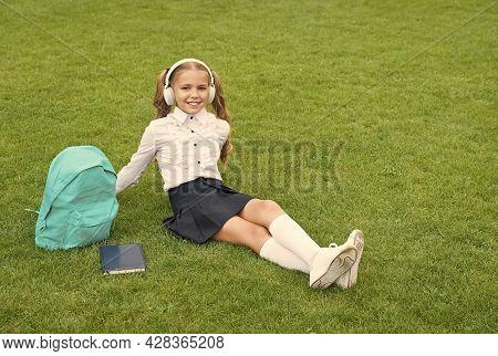 Ordinary Day Of Online Learning. Cute Girl Listen Music. Happy Preschool Girl With Book In School Ya