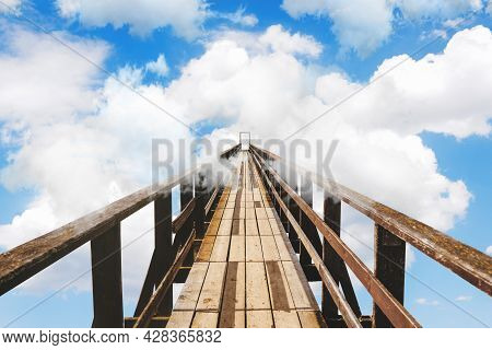 Wooden Bridge Going Into The Clouds. Clouds In The Sky With A Bridge. Unknown, Success Or Fear Conce