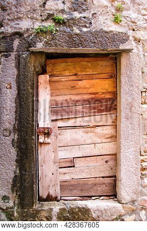 Very Old Rustic Wood Door. A Wooden Door In A Rural Third World Country House. Housing Insurance. Ba