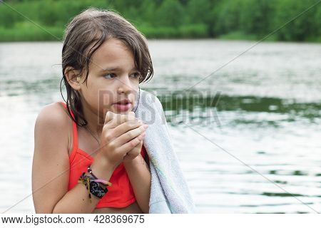 Sad Froze Teenage Caucasian Girl Shivering After Bathing In The Lake In Summer Day