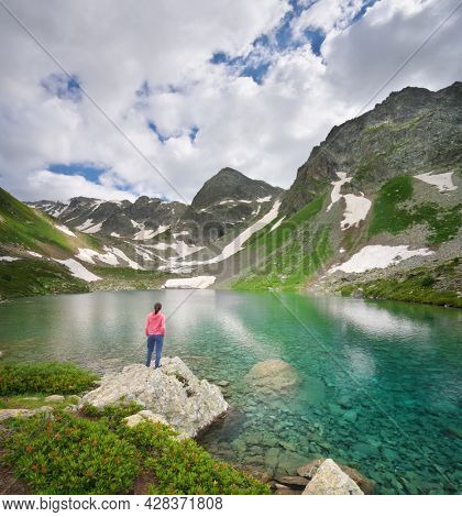 Landscape of Caucasus Dukka lake in mountain. Person and nature. Travel and relax scene.