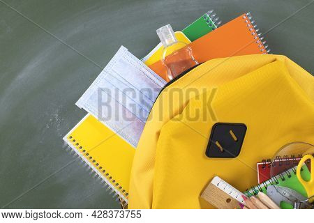 Backpack Prepared With School Supplies And Mask For The Return To School.