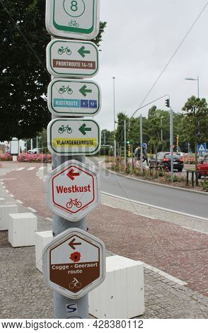 Nieuwpoort, Belgium, 15 July 2021: Signpost With Directional Information For A Number Of Different C
