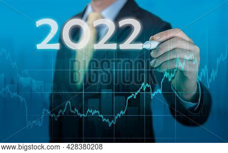 Businessman In Suit Forecast Analysis Plan Profit Chart. Economic Forecasts For 2022. Businessman Wr