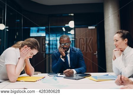 Sad Businessman And Businesswoman Team At Office Meeting. Business People Group At Office In Crisis