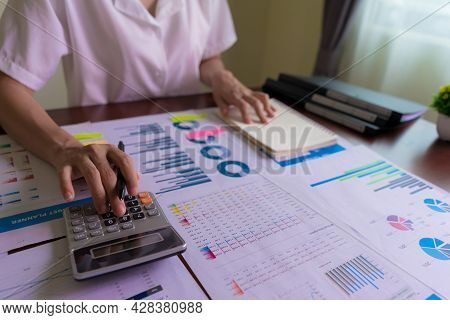 An Accountant Or Businesswoman Is Calculating Statistical Graphs About Finance, Company Accounts, Ta