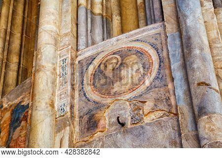 Bergamo, Italy - May 22, 2019: Ancient Frescoes On The Outside Wall Of The Building Of The Basilica